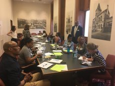 Community health care workers at city hall discussing their challenges to deliver resources to their communities.
