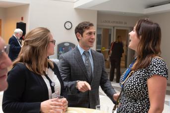 May 30, 2018 - Co-author and MGG co-director Dr. Panagis Galiatsatos greets MGG Advisor Kirsten Gercke and intern Amber Follin at his book reveal.
