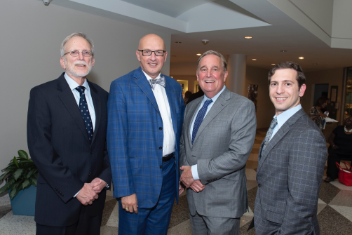 """May 30, 2018 -- Book reveal for """"Building Healthy Communities Through Medical Religious Partnerships""""(L to R): Auth. Daniel Hale (PhD), Pres. Kevin Sowers (MSN, RN, FAAN), Richard Bennett (MD), Auth. Panagis Galiatsatos (MD)"""