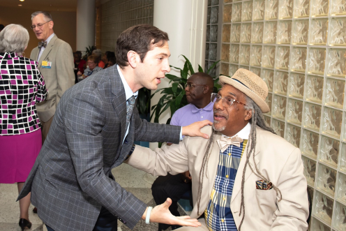 May 30, 2018 -- Dr. Galiatsatos greeting a member of the community who commonly works with MGG