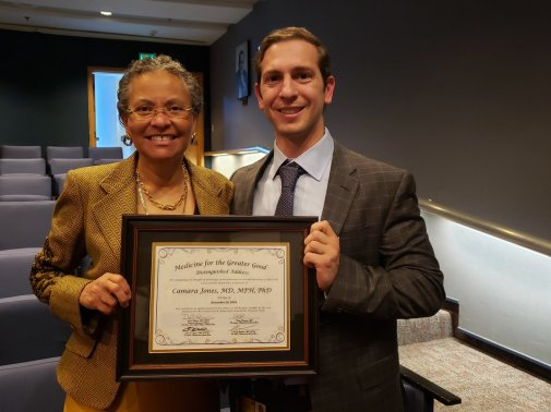 Camara Jones receiving a certificate for giving a distinguished address at our 2018 MGG Symposium.